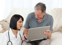 Mature man with his nurse Stock Images
