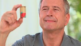 Mature man with his pills stock video footage