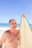 Mature man with his surfboard Royalty Free Stock Photo