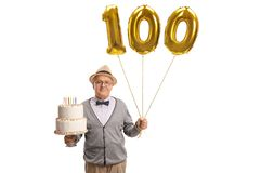 Mature man holding a birthday cake and golden number hundred bal Royalty Free Stock Image