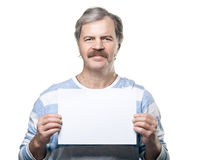 Mature man holding a blank billboard isolated. On white background stock photo