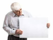 Mature man holding a blank billboard over white Royalty Free Stock Photo