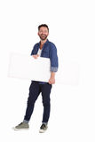 Mature man holding blank billboard and smiling royalty free stock photography