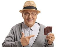 Mature man holding a chocolate bar and pointing Stock Photography