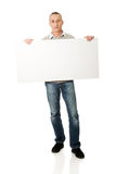 Mature man holding empty banner Stock Images