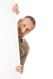 Mature man holding empty banner Royalty Free Stock Image