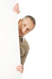 Mature man holding empty banner Royalty Free Stock Photos