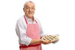 Mature man holding a freshly baked pie Royalty Free Stock Photography