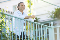 Mature man on vinyard balcony. Royalty Free Stock Photo
