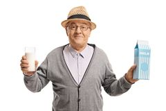 Mature man holding a glass of milk and a milk carton. Isolated on white background Stock Photography