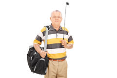 Mature man holding a golf club and a sports bag Stock Images