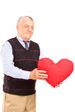 Mature man holding red heart Royalty Free Stock Images