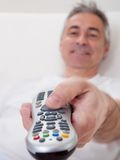 Mature Man Holding Remote Control Stock Photo