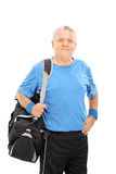 Mature man holding a sports bag Stock Image