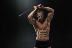 Mature Man Holding Sword Ready To Fight Royalty Free Stock Photography