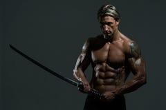 Mature Man Holding Warrior Sword Royalty Free Stock Photo