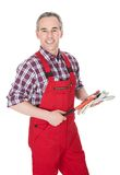 Mature man holding wrench Royalty Free Stock Images