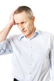 Mature man with huge headache Royalty Free Stock Image