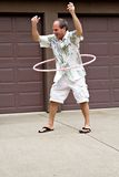 Mature man with hula hoop!. A mature man - 55 years old - plays with a hula hoop royalty free stock photos