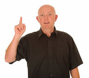 Mature man with idea. Middle aged with idea pointing upwards with finger, white background stock photography