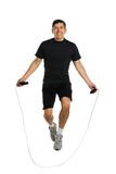 Mature Man Jumping Rope. Mature Hispanic man jumping rope isolated over white background Stock Photography