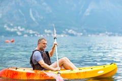 Mature man kayaking on the sea Stock Images