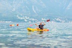 Mature man kayaking on the sea Stock Photos