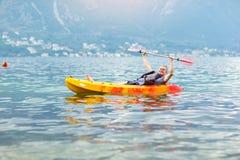 Mature man kayaking on the sea Royalty Free Stock Photos