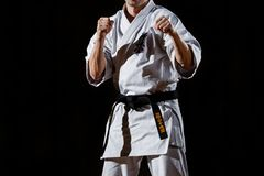 Mature man keeping his fists in karate stance. Before fight stock image