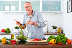 Mature man in the kitchen VIII Stock Photos