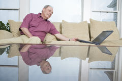 Mature man with laptop Stock Photography