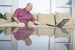 Mature man with laptop Stock Photography