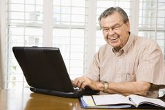 Mature man with laptop. Stock Photos