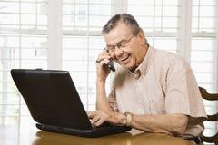 Mature man with laptop. Royalty Free Stock Photos
