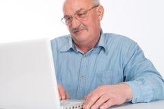 Mature man with laptop Royalty Free Stock Photos