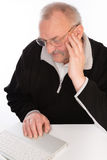 Mature man with laptop Royalty Free Stock Photography