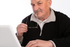 Mature man with laptop Stock Photo