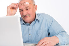 Mature man with laptop Royalty Free Stock Image