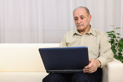 Mature man with laptop Stock Image