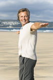 Mature man laughing on beach. Royalty Free Stock Photos