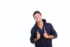 Mature man laughing and standing against white background. Portrait of a mature man laughing and standing against white background stock photos
