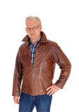 Mature man in leather jacket standing. Royalty Free Stock Images