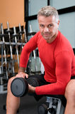 Mature man lifting dumbbells Royalty Free Stock Photography
