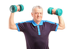 A mature man lifting up a dumbbells Stock Photos