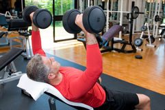 Mature man lifting weights Stock Image
