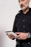 Mature man looking at his digital tablet Stock Photo