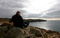 Mature man looking out to sea Royalty Free Stock Images
