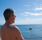 Mature man looking at sea Stock Image
