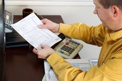 Mature Man looking at Tax Form Print Out Stock Photos