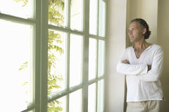 Mature man looking at the window. Royalty Free Stock Photos